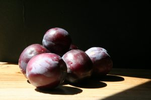 Inspirations from mounded plums in the sunlight.
